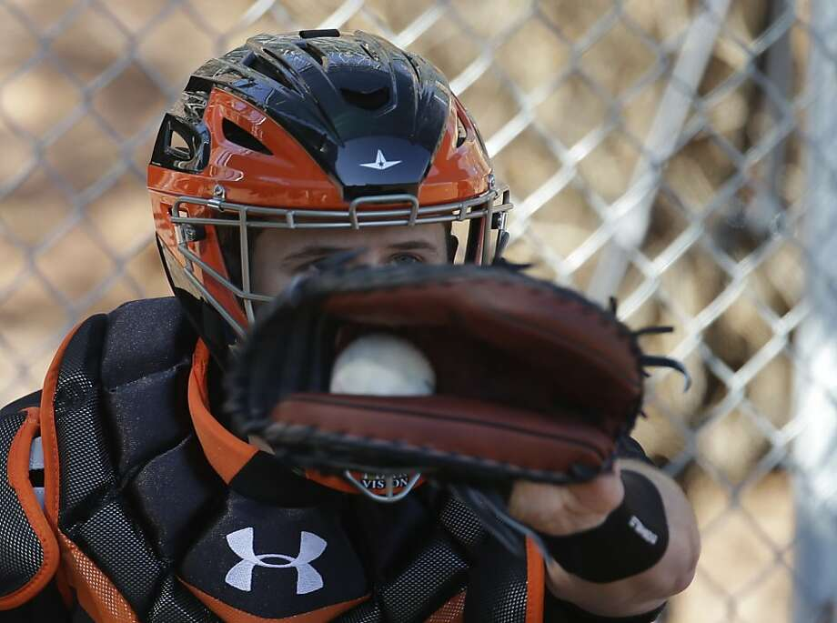 San Francisco Giants' Buster Posey catches during a spring training baseball workout Wednesday, Feb. 13, 2013, in Scottsdale, Ariz. (AP Photo/Darron Cummings) Photo: Darron Cummings, Associated Press