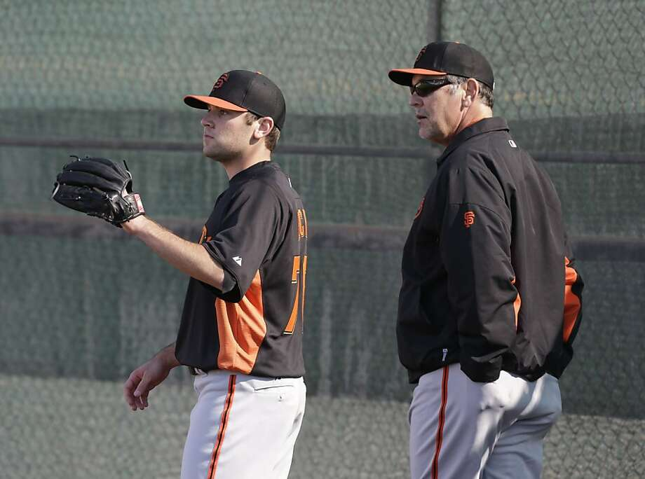 San Francisco Giants manager Bruce Bochy watches as his son, Brett Bochy, throws during a spring training baseball workout Wednesday, Feb. 13, 2013, in Scottsdale, Ariz. (AP Photo/Darron Cummings) Photo: Darron Cummings, Associated Press