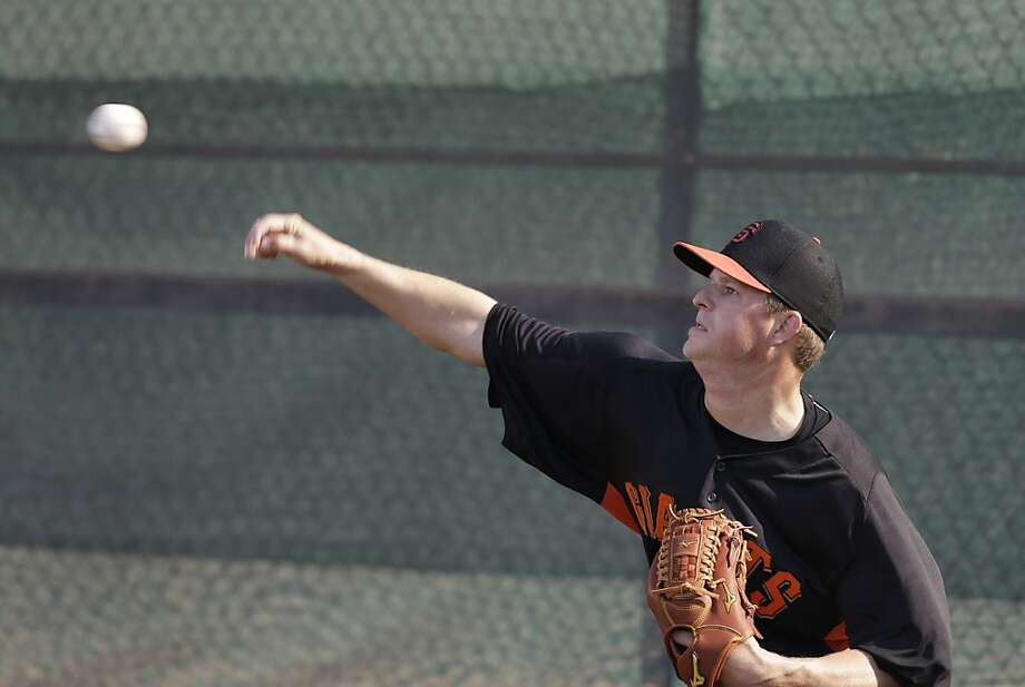 San Francisco Giants' Matt Cain throws during a spring training baseball workout Wednesday, Feb. 13, 2013, in Scottsdale, Ariz. (AP Photo/Darron Cummings) Photo: Darron Cummings, Associated Press