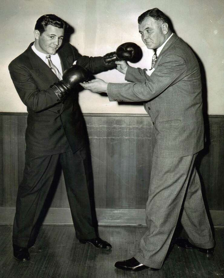 "Fairfielder Bernie Reynolds, left, poses with renowned ""Cinderella Man"" Jim Braddock, in a playful pose circa 1946. Photo: Contributed Photo"