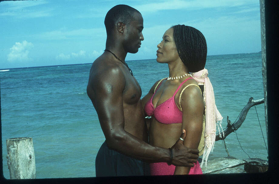 Taye Diggs and Angela Bassett in HOW STELLA GOT HER GROOVE BACK.  He is how she got her groove back.