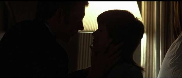 Klute -- featuring the silhouettes of Jane Fonda and Donald Sutherland.