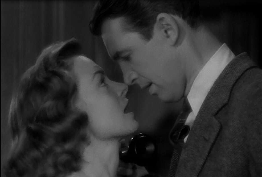 James Stewart and Donna Reed, no longer able to deny it or put it off in IT'S A WONDERFUL LIFE.