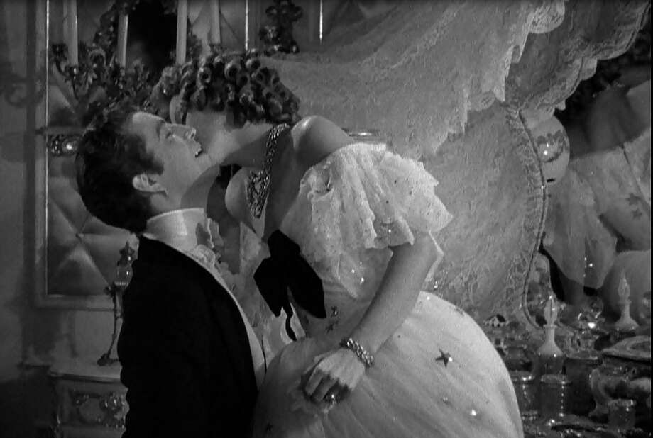 Camille:  Garbo surprises Robert Taylor by kissing him all over his face, in this classic scene from the 1937 film.