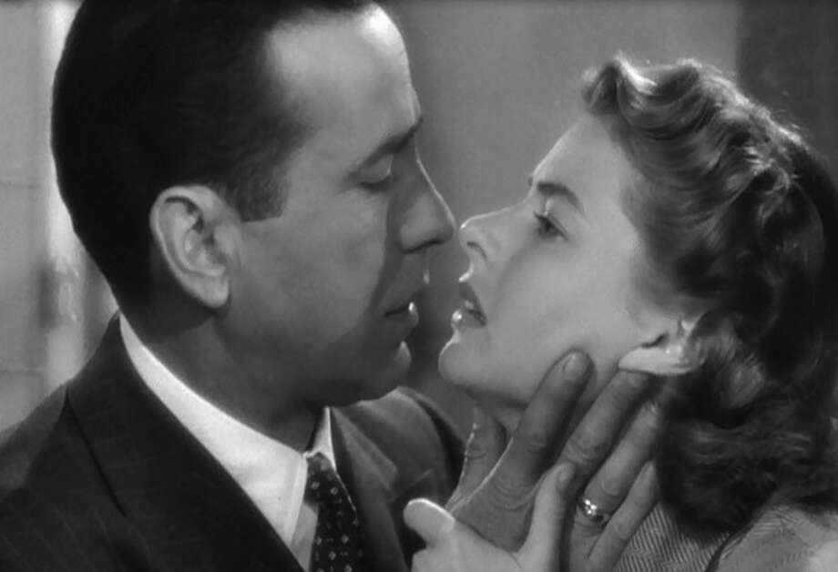 Casablanca -- the first of two great kisses in this film, this from the Paris flashback. She is about to ask Bogart to kiss her as if it were the last time.