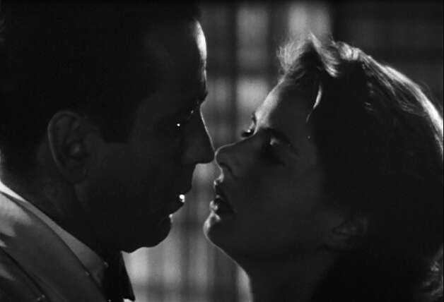Casablanca -- the second of two memorable kisses from this film -- this comes when Ilsa can't take it anymore and gives in to her misery and attraction for Rick.