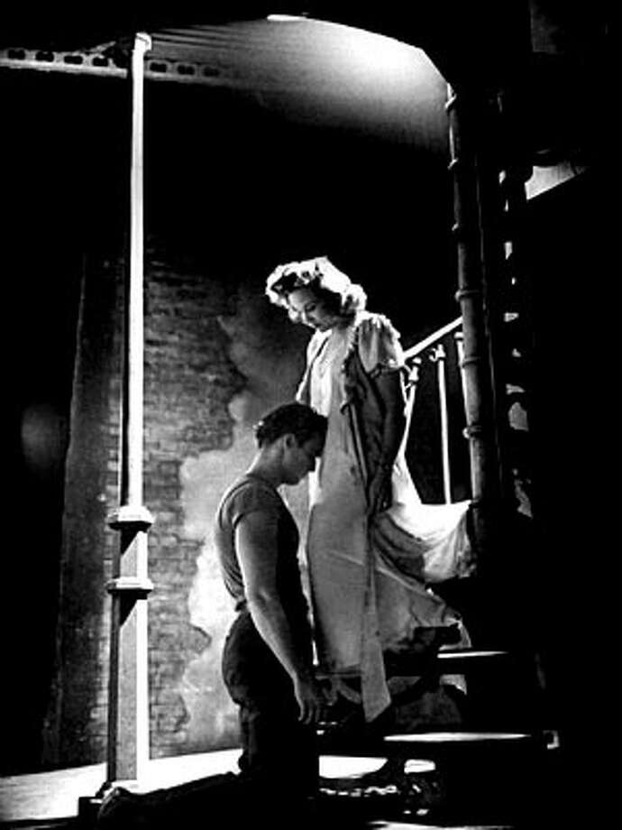 Marlon Brando and Kim Hunter in the steamy moment from STREETCAR.  This is from the stage production, but same idea.