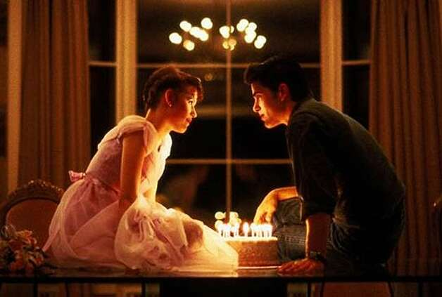 Molly and Michael Schoeffling in SIXTEEN CANDLES -- suggested by rolo80.