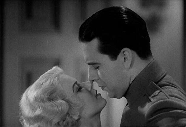 Jean Harlow and Ben Lyon in Hell's Angels -- she has just slipped into something more comfortable.  That's where the phrase comes from -- this scene. Photo: HO, REUTERS / X80001