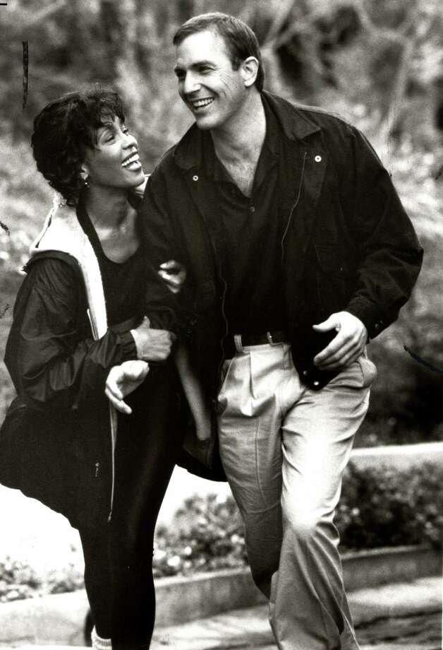 Whitney Houston (with Kevin Costner) in The Bodyguard,  1992. The big kiss comes at the end, when she stops the plane . . . Photo: Handout / chronicle