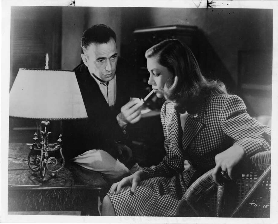 Humphrey Bogart and Lauren Bacall in To have and Have Not.  The big kiss (actually two kisses -- it's even better when he helps) comes in the whistle scene. Photo: Warner Bros. / HO
