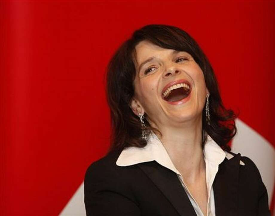 THE UNBEARABLE LIGHTNESS OF BEING was suggested, for Juliette Binoche, depicted here years later.
