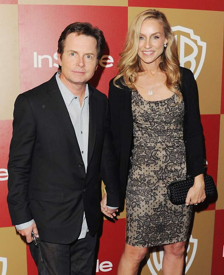 "Actor Michael J. Fox and Tracy Pollan met while filming the '80s sitcom ""Family Ties."" They married in 1988.  Photo: Jon Kopaloff, FilmMagic"