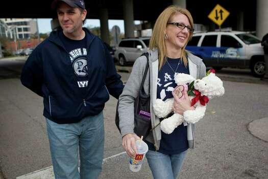 Travis and Karen Jackson of Paris, Texas brought a valentine's gift for their daughter Carlie, 20, who is stuck onboard the Carnival Triumph ship as they prepared to reunite with their daughter at the Alabama Cruise Terminal Wednesday, Feb. 13, 2013, in Mobile. 