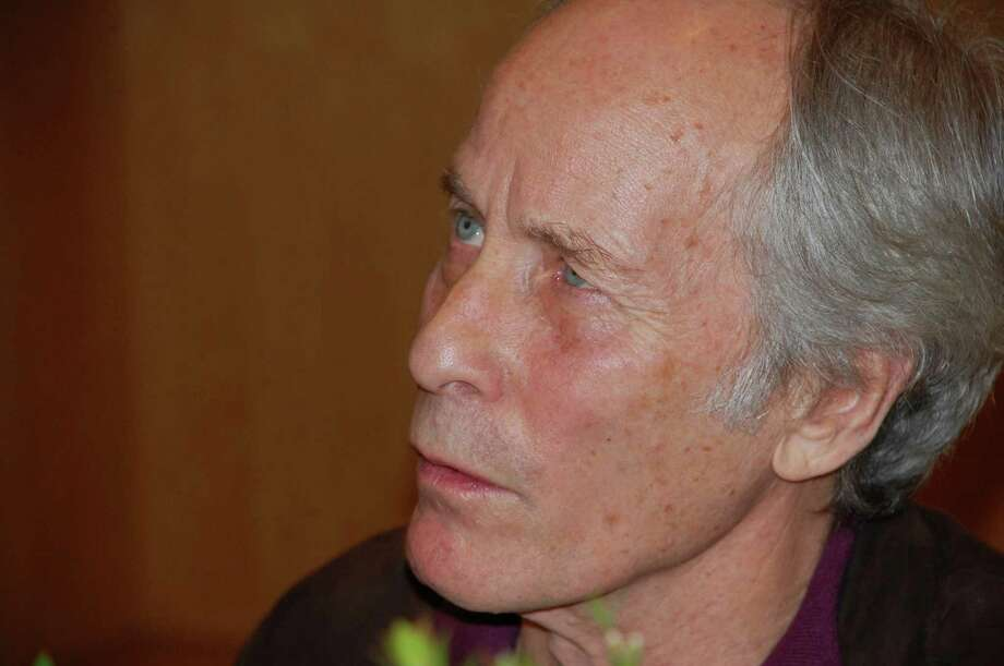 "Jarret Liotta/For the Darien News Pulitzer Prize-winning author Richard Ford read from and signed copies of his book ""Canada"" during an appearance at the Darien Library on Sunday, Feb. 10. Photo: Contributed"