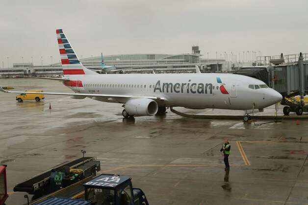 US Airways management will run the merged airline, but it will keep the American brand, including the new logo and paint job the airline rolled out in January. Photo: Scott Olson, Getty Images / 2013 Getty Images