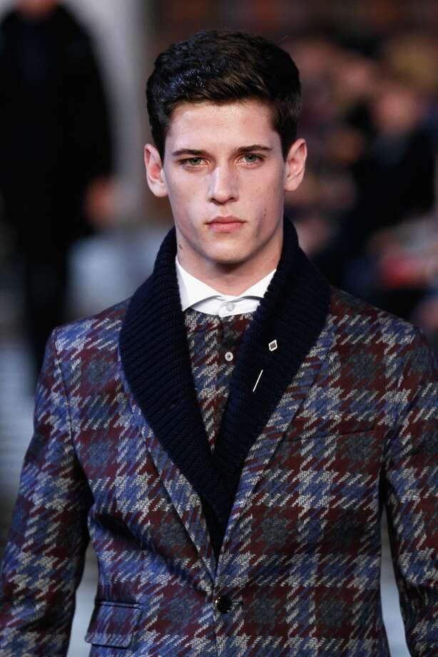 A model walks the runway at Tommy Hilfiger Men's Fall 2013 fashion show during Mercedes-Benz Fashion Week at Park Avenue Armory on February 8, 2013 in New York City. Photo: Peter Michael Dills / 2013 Getty Images