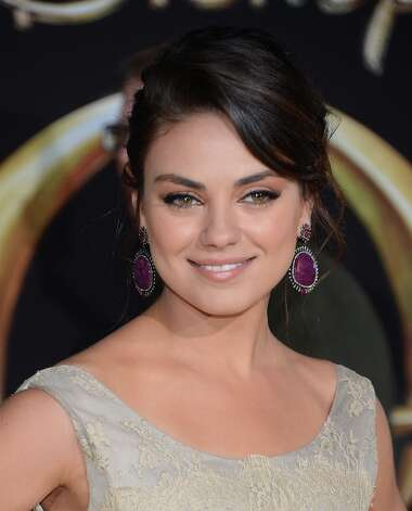Actress Mila Kunis attends the premiere Of Walt Disney Pictures' Oz The Great And Powerful at the El Capitan Theatre on February 13, 2013 in Hollywood, California. Photo: Jason Kempin, Getty Images / 2013 Getty Images
