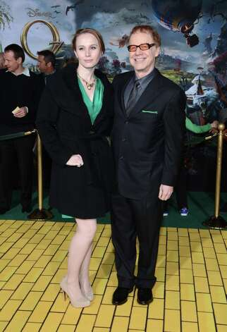 Composer Danny Elfman (R) and Mali Elfman arrive for the world premiere of Walt Disney Pictures' Oz The Great And Powerful at the El Capitan Theatre on February 13, 2013 in Hollywood, California. Photo: Jason Kempin, Getty Images / 2013 Getty Images