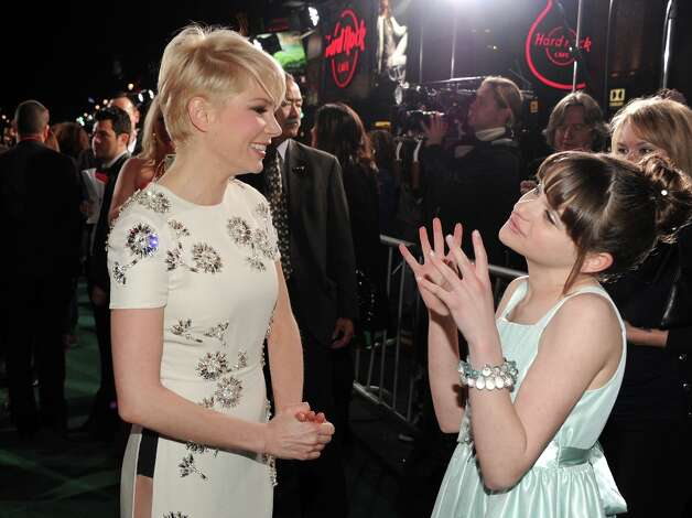 Actors Michelle Williams and Joey King attend the world premiere of Walt Disney Pictures' Oz The Great And Powerful at the El Capitan Theatre on February 13, 2013 in Hollywood, California. Photo: Kevin Winter, Getty Images / 2013 Getty Images