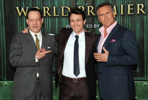 (L-R) Actors Ted Raimi, James Franco and Bruce Campbell attend the world premiere of Walt Disney Pictures' Oz The Great And Powerful at the El Capitan Theatre on February 13, 2013 in Hollywood, California. Photo: Kevin Winter, Getty Images / 2013 Getty Images