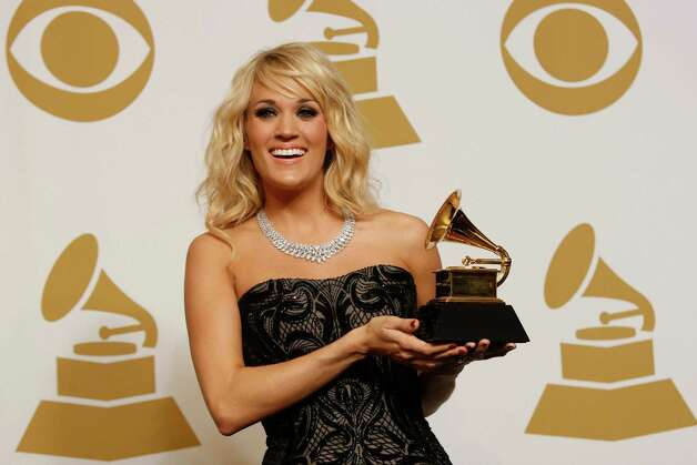Carrie Underwood: The country music star has a classic American model - a Ford Mustang.