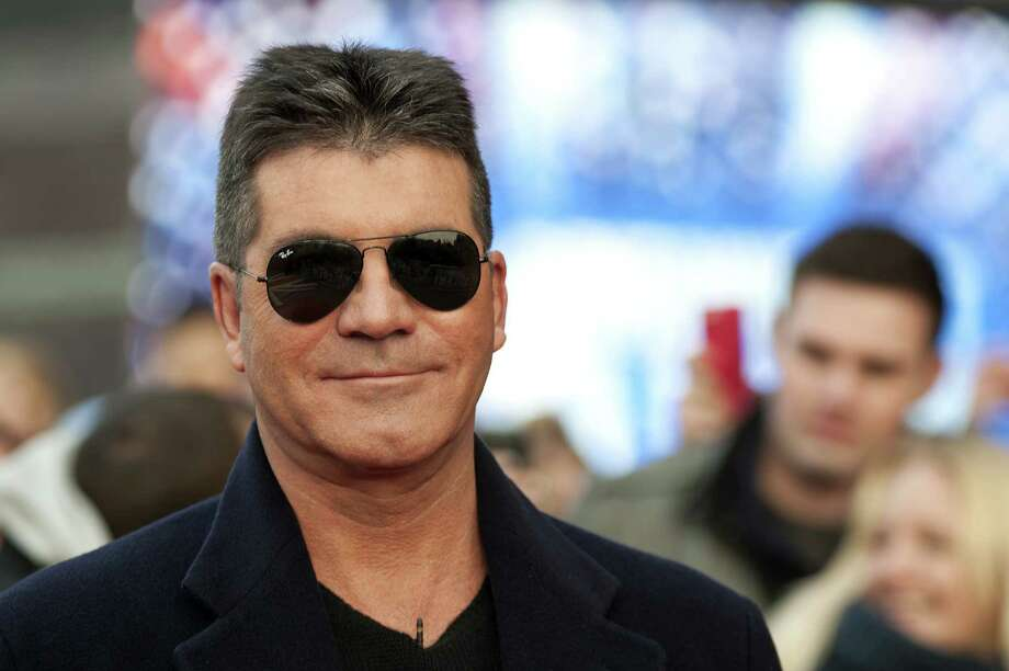 Simon Cowell: Cowell is all class with a Bugatti Veyron.
