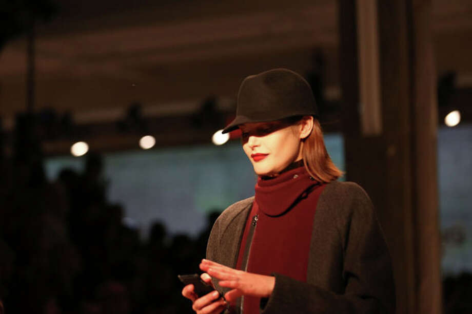 Hats, scarves and smartphones  (Photo by Chelsea Lauren/Getty Images for Mercedes-Benz Fashion Week) Photo: Chelsea Lauren, (Credit Too Long, See Caption) / 2013 Getty Images