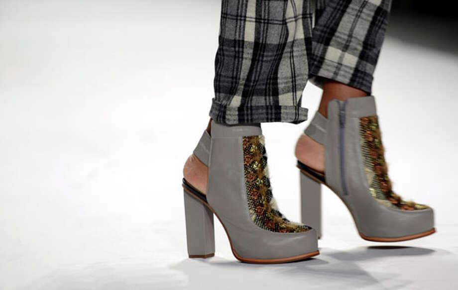 Snakeskin-embellished peep-heel platform boots. Photo: STAN HONDA, AFP/Getty Images / AFP