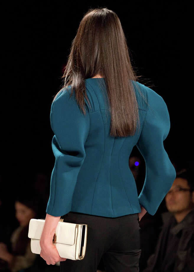 A model walks the runway during the Rebecca Minkoff Fall 2013 fashion show during Fashion Week, Friday, Feb. 8, 2013, in New York. (AP Photo/Karly Domb Sadof) Photo: Karly Domb Sadof, Associated Press / AP