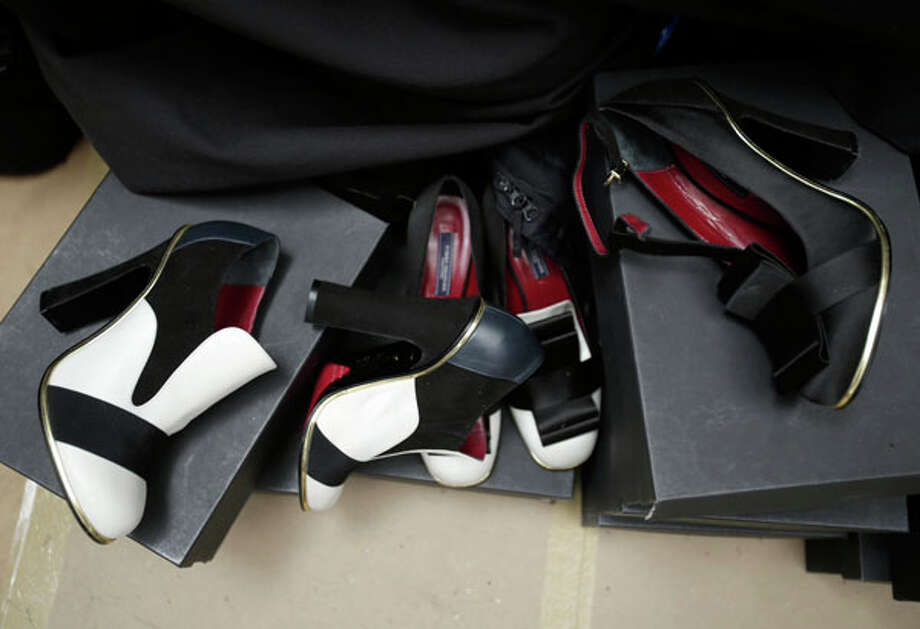 Shoes from the Tommy Hilfiger Fall 2013 collection are ready for models' feet backstage during Fashion Week in New York, Sunday, Feb. 10, 2013.  (AP Photo/Seth Wenig) Photo: Seth Wenig, Associated Press / AP