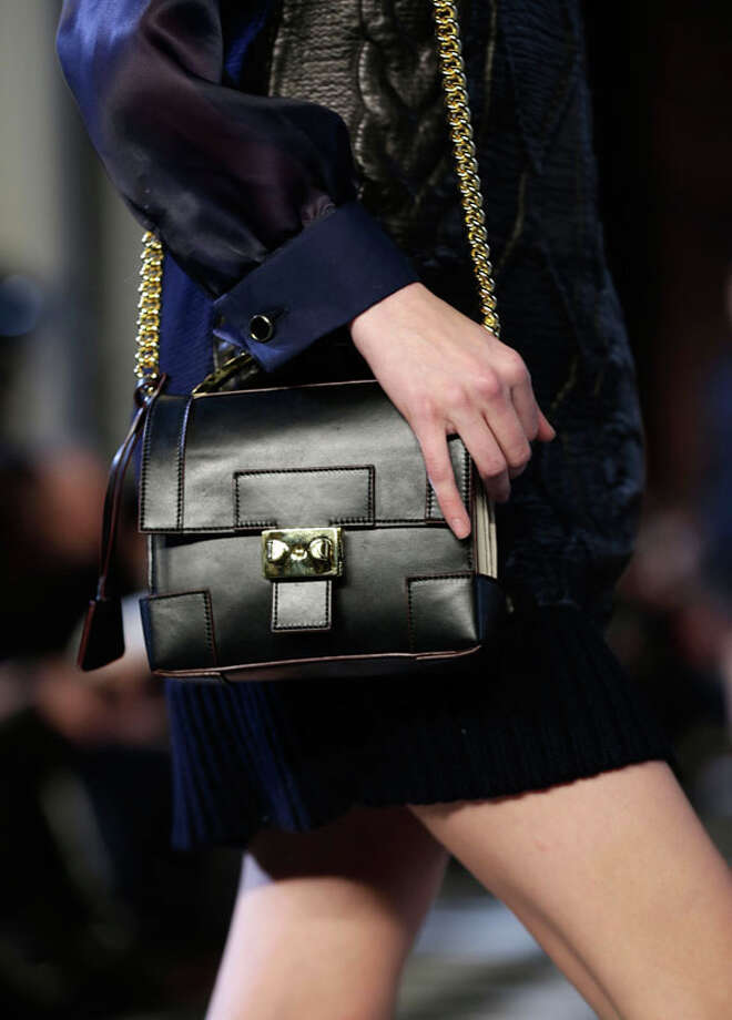 The Tommy Hilfiger Fall 2013 collection is modeled during Fashion Week in New York, Sunday, Feb. 10, 2013.  (AP Photo/Seth Wenig) Photo: Seth Wenig, Associated Press / AP