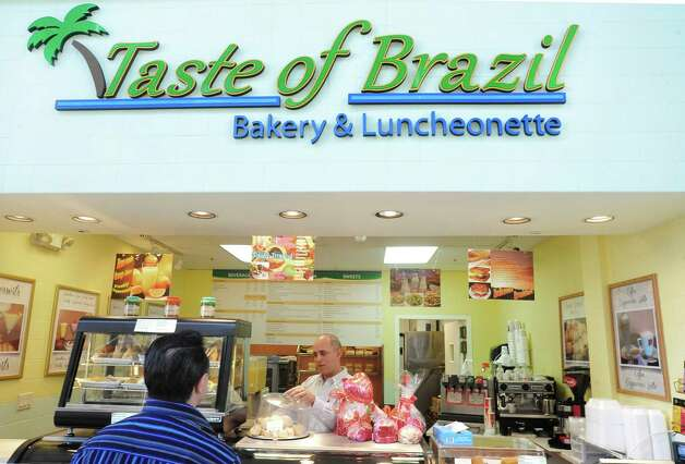 Alex Meca works in his bakery, Taste of Brazil, at the Danbury Fair mall, Danbury, Conn.Thursday, Feb. 14, 2013. Photo: Michael Duffy / The News-Times
