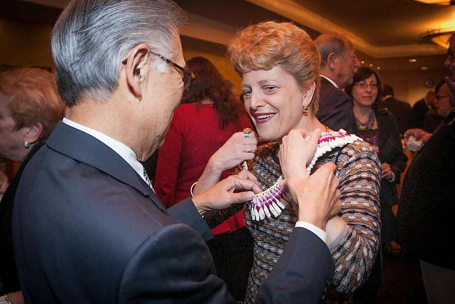 Dale Ikeda assists Carey Perloff with her necklace during A.C.T.'s annual Producers Circle dinner. Photo: Drew Altizer Photography