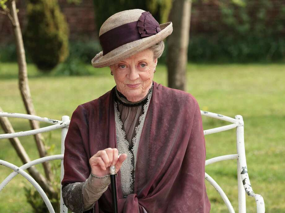 "In this image released by PBS, Maggie Smith as the Dowager Countess Grantham, is shown in a scene from the second season on ""Downton Abbey.""  The 78-year-old actress, who portrays Lady Grantham in the popular PBS series, told ""60 Minutes"" that she hasn't watched the drama because doing so would only make her agonize over her performance. She said she may watch it someday. (AP Photo/PBS, Carnival Film & Television Limited 2011 for MASTERPIECE, Nick Briggs) Photo: Nick Briggs"