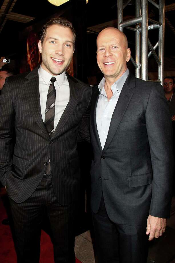 "This image released by Starpix shows Jai Courtney, left, and Bruce Willis at the premiere of their film ""A Good Day to Die Hard,"" at AMC Empire 25 Theatre in New York on Wednesday, Feb. 13, 2013.  The film, the fifth in the ""Die Hard"" series, opens on Thursday. (AP Photo/Starpix, Dave Allocca) Photo: Dave Allocca"