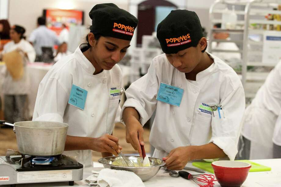 Cy Fair Culinary Academy students Monica Gowda and Jonathan Lee prepare a three-course menu consisting of lamb loin, crushed fingerling potatoes, and ratatouille during the 2013 Texas ProStart Invitational on Tuesday, Feb. 12, 2013, in Humble. Teams from all over Texas competed in this management and culinary competition. ( J. Patric Schneider / For the Chronicle ) Photo: J. Patric Schneider, Freelance / © 2013 Houston Chronicle