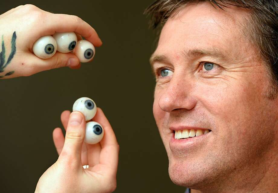 Stop rolling your eyes at me: An employee of Madame Tussauds in Sydney tries to match the eye color of Australian cricket legend Glenn McGrath with that of sample eyeballs. Tussauds takes over 250 measurements before making a final wax figure. Photo: William West, AFP/Getty Images