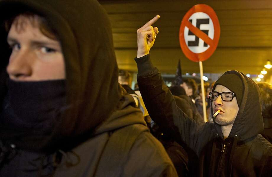 One-finger salute to the neo-Nazis:Left-wing demonstrators protest a far-right march marking the 67th anniversary of the Allied bombing of Dresden, Germany, in World War II. The raid sparked a firestorm that destroyed much of the historical center of the city. Photo: Robert Michael, AFP/Getty Images