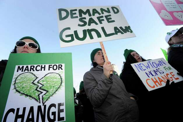 "From left, Iva Kuchenbrod, her sister, Soledad Akbar, and Rebekah Harriman-Stites, of Newtown participate in Thursday's  ""March for Change"" rally is held on the steps of the Capital in Hartford, Conn., Thursday, Feb. 14, 2013, to promote common sense and practical changes to the state's gun laws. Photo: Carol Kaliff / The News-Times"