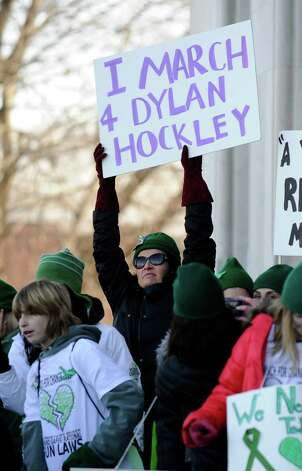"A participant in Thursday's ""March for Change"" rally held on the steps of the Capital in Hartford, Conn., Thursday, Feb. 14, 2013, to promote common sense and practical changes to the state's gun laws, holds a sign supporting Sandy Hook shooting victim, Dylan Hockley. Photo: Carol Kaliff / The News-Times"