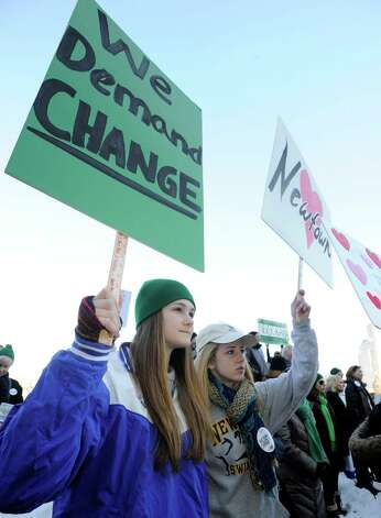 "Eliza Egglestan, 15, and her sister Zoe, 18, of Newtown, participate in Thursday's ""March for Change"" rally held on the steps of the Capital in Hartford, Conn., Thursday, Feb. 14, 2013, to promote common sense and practical changes to the state's gun laws. Photo: Carol Kaliff / The News-Times"