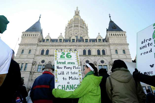 "Hana Rosenthal, 12, of Newtown, participates in Thursday's ""March for Change"" rally held on the steps of the capital in Hartford, Conn., Feb. 14, 2013. Photo: Carol Kaliff / The News-Times"