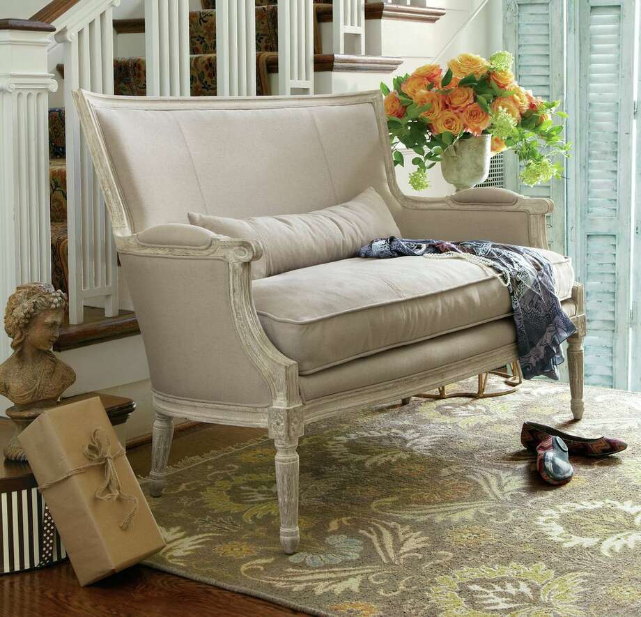 Soft Surroundings just opened its first Houston-area store in The Woodlands mall, featuring Retreat, a new line of French-inspired home furnishings. Isla Settee, $899.95.