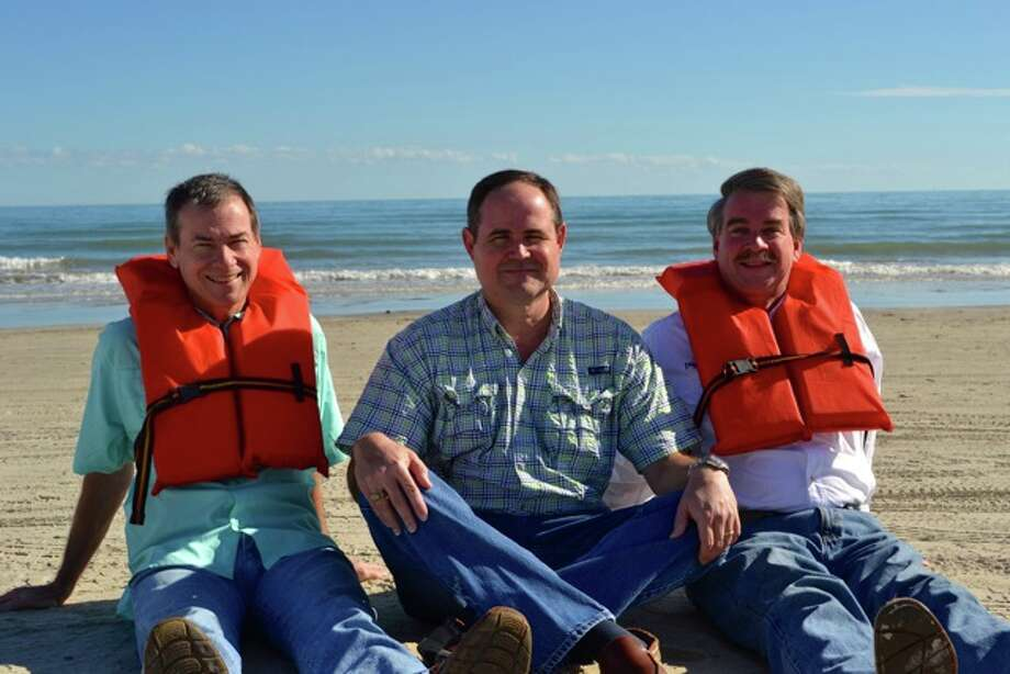 Now: While putting together a photographic history of the Mitchell family at the beach, someone pulled out a snapshot of Lane, Andy and Bill Mitchell taken almost 50 years earlier. So the brothers (today the vice-president, CFO and president, respectively, of G.W. Mitchell & Sons, Inc. General Contractors), decided to re-create it here, complete with old-school life preservers. Photo: Mitchell, Reader Submission