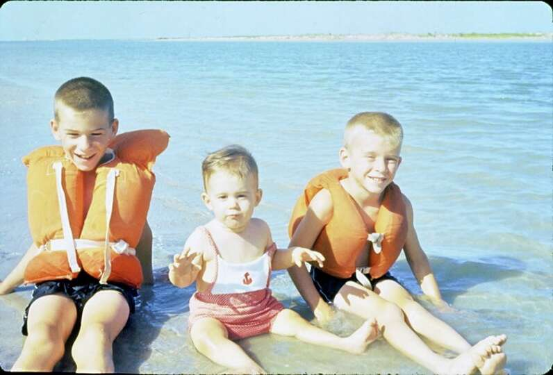 Then: The Mitchell boys, Lane, 7, Andy, 1, and Bill, 6, enjoy the beach at Port Aransas almos