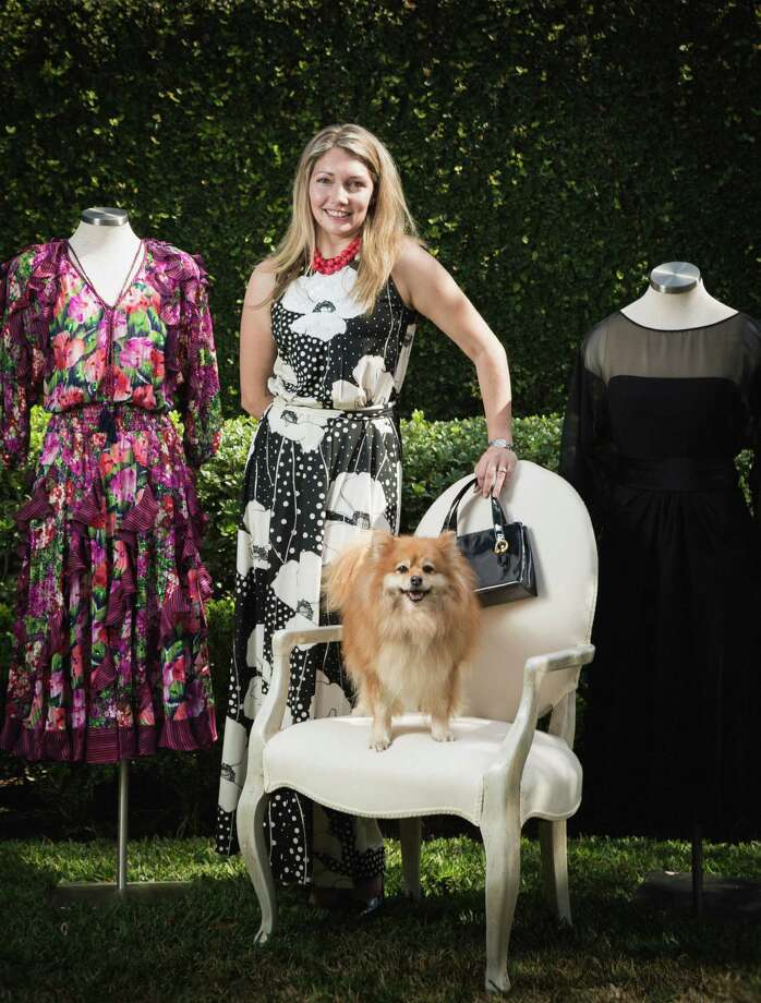 Jen Meneely, seen with her dog, Taz, wears a two- tone '60's Leo Narducci maxi dress, vintage black-patent purse.   On the mannequins: Left: A floral '70's dress by Diane Freis. Right: A '60's black-crepe dress by Estevez for Lillie Rubin.  All items available at www.shopjenscloset.com. Photo: Michael Paulsen, Staff / © 2013 Houston Chronicle