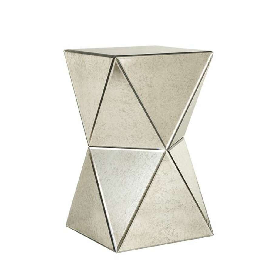 Angular BeautyWest Elm's Faceted Mirror Side Table offers a stylish reflection of your own design know-how. The mirrored surfaces of this side table work in a variety of settings; $199 at West Elm, 3910 Westheimer. Photo: West Elm