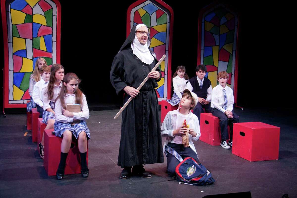 Eric Anderson, as Sister Rudy, conducts class, while the students sit, or kneel, in rapt attention. At left, from front to back, Rachel Resheff, Alison Jaye Horowitz, Noah Radcliffe and Leah Greenhaus. Kneeling is Norwalk resident Kyle Brenn, who played Billy in this 2011 production of