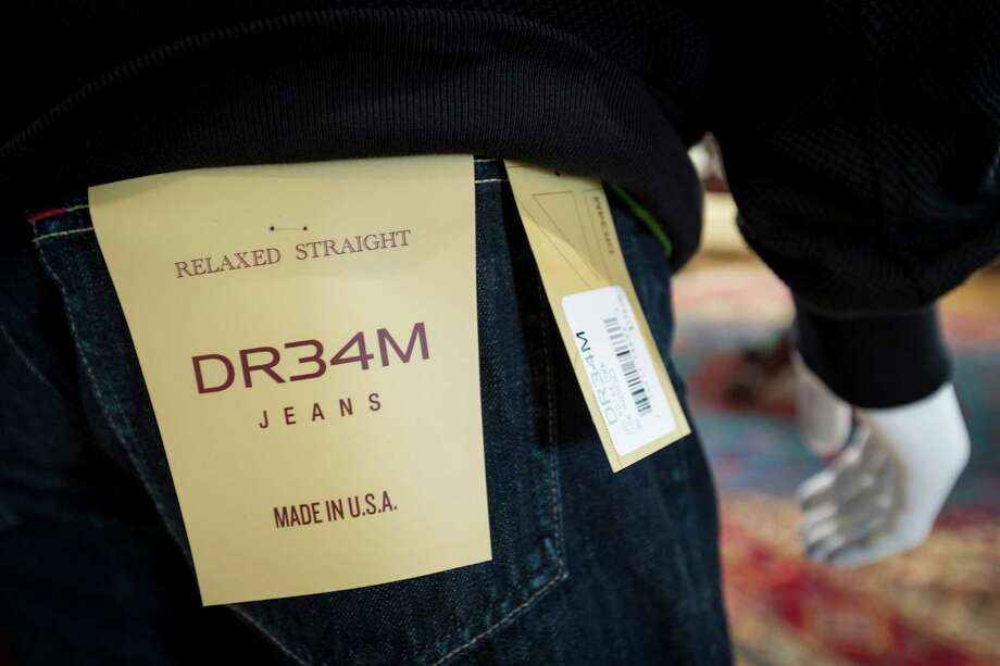 Houston Rockets' legend Hakeem Olajuwon's up-scale clothing line, DR34M, at the West Mansion, Tuesday, Feb. 5, 2013, in Clear Lake.  The 17,000-square foot mansion is the headquarters and showroom for the clothing line, which features leather goods for men and women, men's suiting and custom shirts and shoes.  ( Michael Paulsen / Houston Chronicle ) Photo: Michael Paulsen, Staff / © 2013 Houston Chronicle